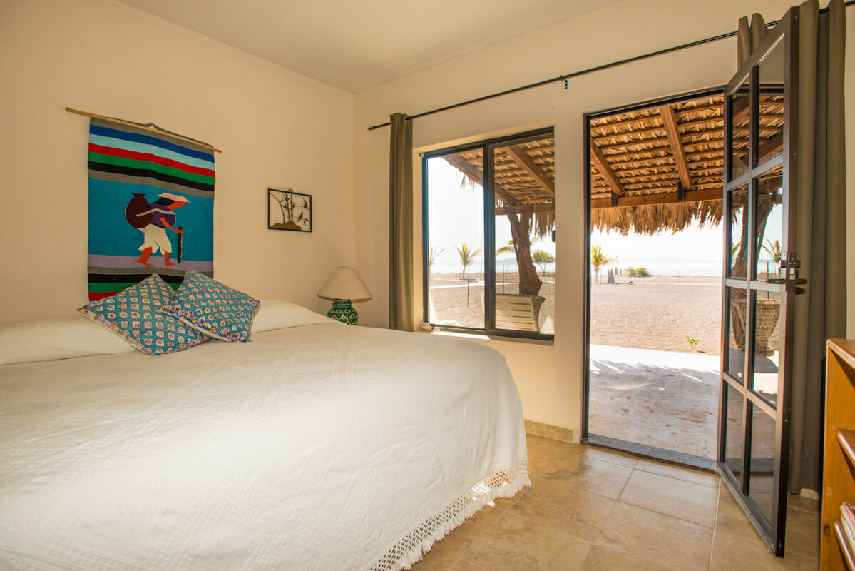 Beachfront House in Loreto Baja guest bedroom with water view and full bath