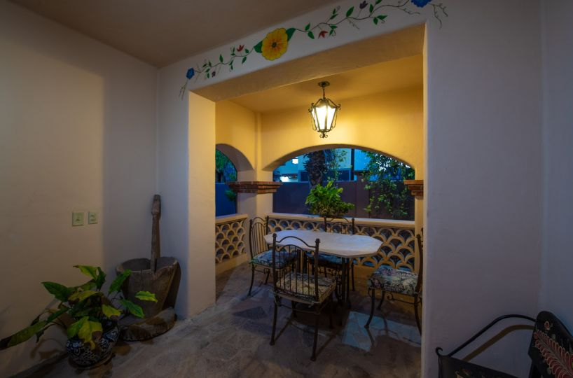 Beautifully restored four bedroom adobe home covered seating area in front entrance
