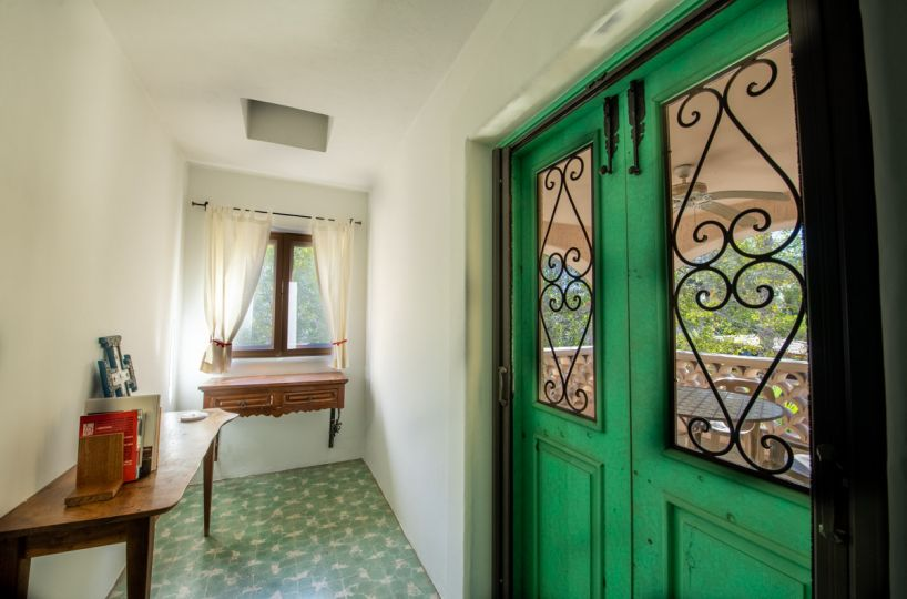 Beautifully restored four bedroom adobe home upstairs hall looking out onto terrace